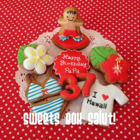 ハワイモチーフのお誕生日用アイシングカップケーキ1